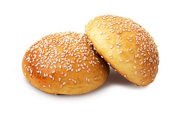Two whole buns with sesame seeds isolated on white