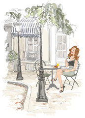 Montmarte in Paris - woman on holiday having breakfast