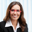 Young cheerful business woman in glasses