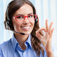 Support phone operator in headset, showing okay gesture