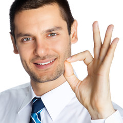 Businessman with okay gesture, on white