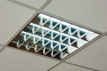 Office ceiling with built-in fluorescent shining lamp