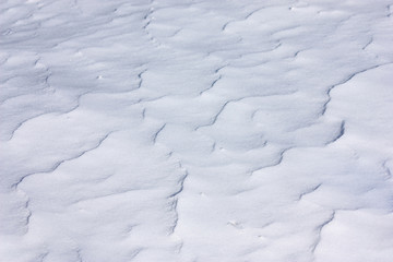Wavy blue snow surface