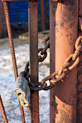 Old Lock and chain on fence.