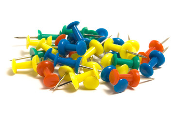 Heap of colored pushpins on the white background