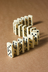 Dominoes on brown background