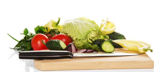 Set of vegetables and knife on the chopping board