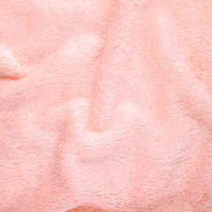 pink texture of bath towel folded as a background