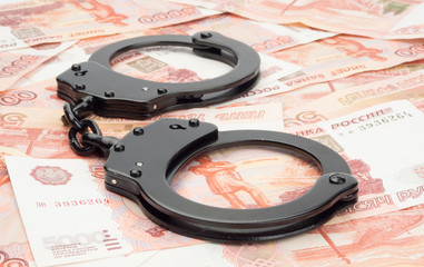 financial crime. Steel handcuffs and money