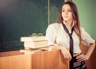 young sexy female teacher portrait indoor
