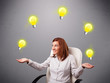 young lady sitting and juggling with light bulbs