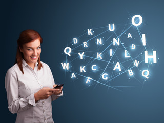 Young woman typing on smartphone with high tech 3d letters commi