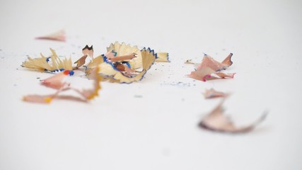 Pencil shavings drop on the white desk isolated