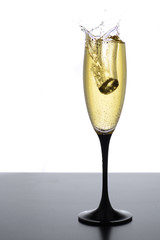 champagne glass with gold ring and splash