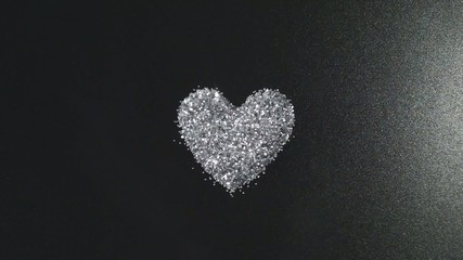 Silver glitter arrange to heart shape with flying light