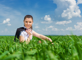 business girl relaxing on field