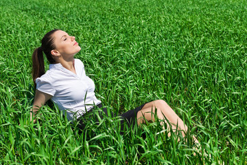 girl relaxing on field