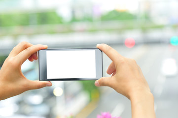 woman hands hold smart phone taking photo in modern city