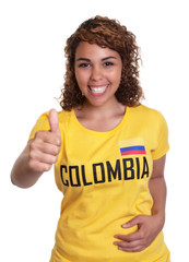Young woman from Colombia showing thumb