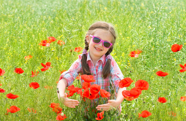 girl on red flower meadow