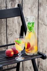 Homemade peach mint lemonade, selective focus