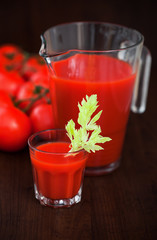 Tomato celery juice in a glass on the table, selective focus