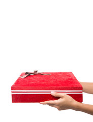 Female hands holding a red giftbox