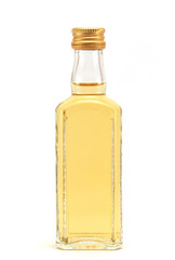 a glass bottle filled with liquid yellow in color