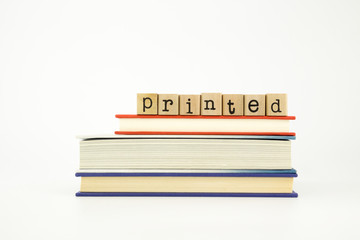 printed word on wood stamps and books