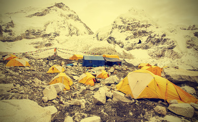 Tents in Everest Base Camp in cloudy day, Nepal, vintage instagr