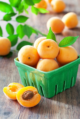 Fresh apricots in bowl on table, selective focus