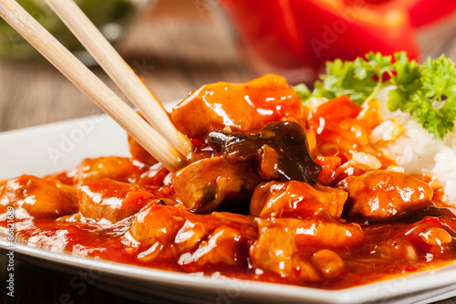 canvas print picture Sweet and sour chicken with rice