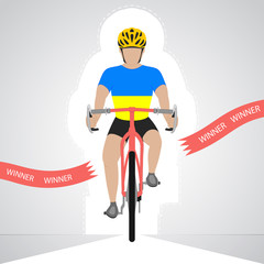 Ukrainian cyclist in front view crossing red finish line