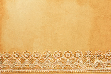 Lace on old grunge paper