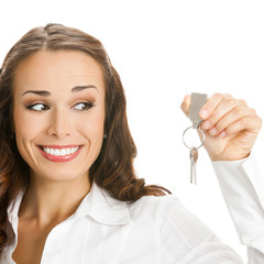 Businesswoman or real estate agent showing keys, isolated