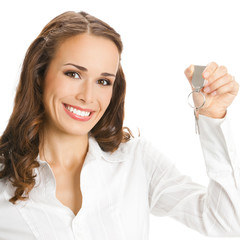Businesswoman or real estate agent showing keys