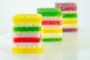 Сandies of fruit jelly on a white background in a row