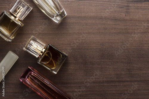 different perfume bottles on the table - 66823499