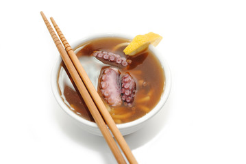 Oriental Noodle and Octopus Soup with Chopsticks