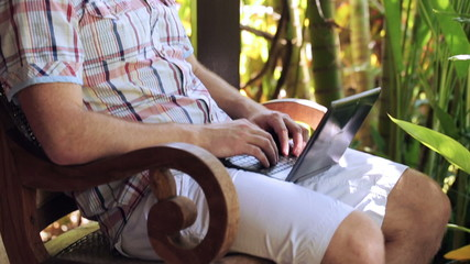 Man fall asleep during working on laptop in the garden