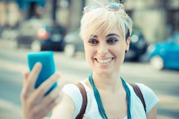 beautiful young blonde short hair hipster woman selfie