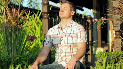 Man enjoying sun in the garden