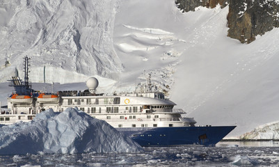 tourist ship on the background of mountains and glaciers of the