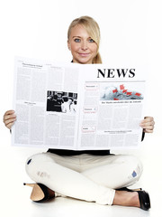 Woman is reading newspaper