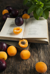 Still life with fresh fruits and vintage books
