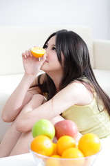 woman with fresh fruits orange