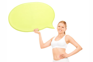 Woman in cotton underwear holding a speech bubble