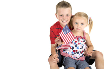 caucasian boy holding blond blue eyed girl with American flag