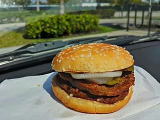 Fast Food Hamburger on a Car Dashboard