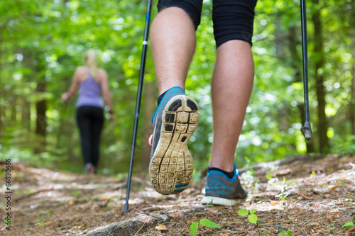 Young couple hiking in nature. Sport and exercise. - 66830466